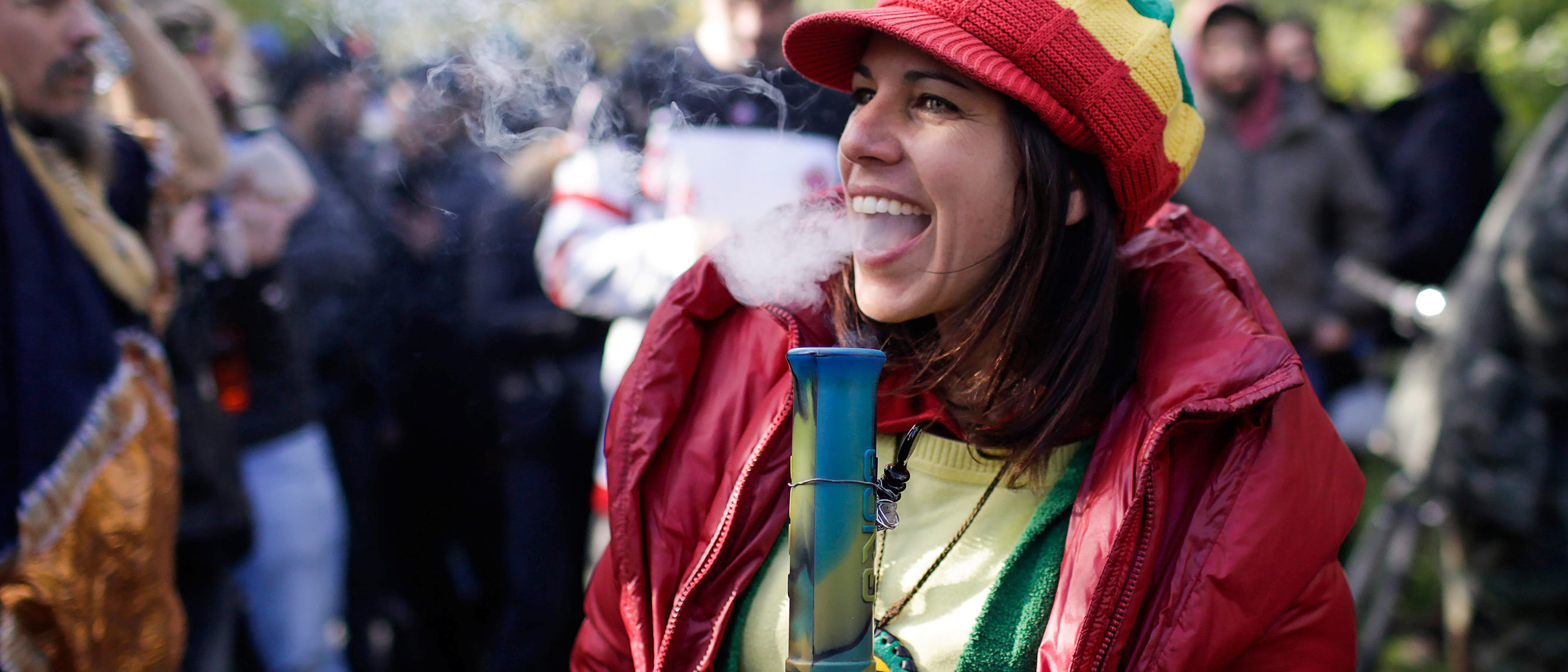 A woman smokes a bong on the day Canada legalizes recreational marijuana at Trinity Bellwoods Park, in Toronto, Ontario, Canada, October 17, 2018. REUTERS/Carlos Osorio