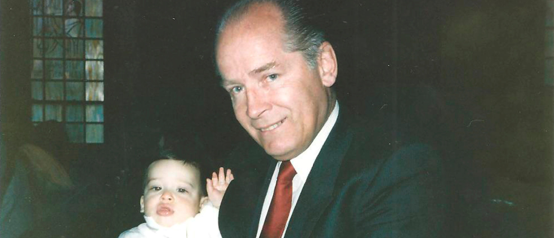 "FILE PHOTO: James ""Whitey"" Bulger holds John Martorano's youngest son, John Jr., during his Christening ceremony in this undated handout photo provided by the U.S. Attorney's Office of Massachusetts June 18, 2013. U.S. Attorney's Office of Massachusetts/Handout/File"
