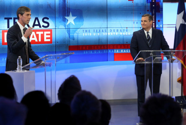 U.S. Rep. Beto O'Rourke (L), faces U.S. Senator Ted Cruz, in debate at the KENS-5 Studios in San Antonio, Texas, U.S., October 16, 2018. Tom Reel/San Antonio Express-News/Pool