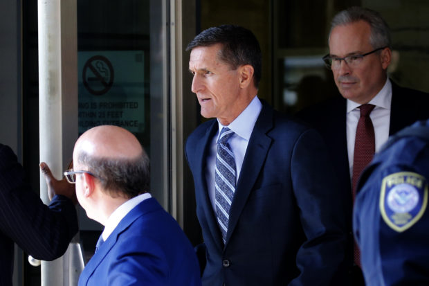Former U.S. National Security Adviser Michael Flynn departs U.S. District Court, where he was expected to plead guilty to lying to the FBI about his contacts with Russia's ambassador to the United States, in Washington, U.S., December 1, 2017. REUTERS/Jonathan Ernst