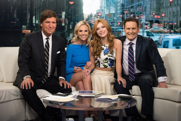NEW YORK, NY - APRIL 02: (L-R) Tucker Carlson, Elisabeth Hasselbeck, actress Bella Thorne and Brian Kilmeade pose onstage during 'Fox & Friends' at FOX Studios on April 2, 2015 in New York City. (Photo by Noam Galai/Getty Images)