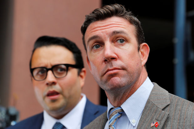 Congressman Duncan Hunter (R-CA) leaves federal court with his lawyer in San Diego, California, U.S. September 24, 2018. REUTERS/Mike Blake