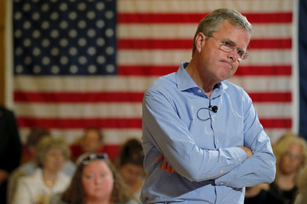 Republican presidential candidate Jeb Bush listens to a question from the audience during a town hall meeting campaign stop at the Medallion Opera House in Gorham, New Hampshire July 23, 2015. REUTERS/Brian Snyder