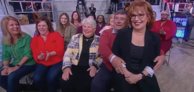 """Joy Behar sits on audience member's lap for a photo on """"The View,"""" 11/2/18/Screen Shot"""