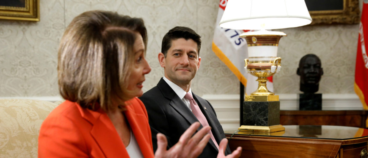 FILE PHOTO: House Democratic leader Nancy Pelosi (L) and Speaker of the House Paul Ryan (R), meet with U.S. President Donald Trump in the Oval Office of the White House in Washington, U.S., December 7, 2017. REUTERS/Kevin Lamarque/File Photo