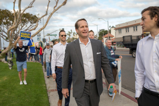 Democratic 48th congressional district candidate Harley Rouda walks with family and supporters to a polling station to vote in midterm elections, in Laguna Beach, California, U.S. November 6, 2018. REUTERS/Monica Almeida