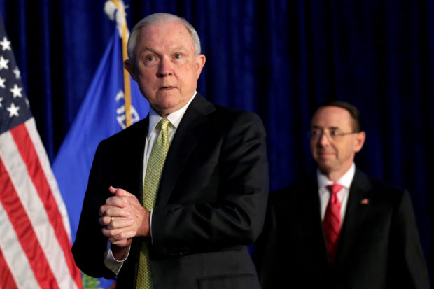 FILE PHOTO: U.S. Attorney General Jeff Sessions (L) and Deputy Attorney General Rod Rosenstein arrive at a summit on crime reduction and public safety in Bethesda, Maryland, U.S., June 20, 2017. REUTERS/Yuri Gripas