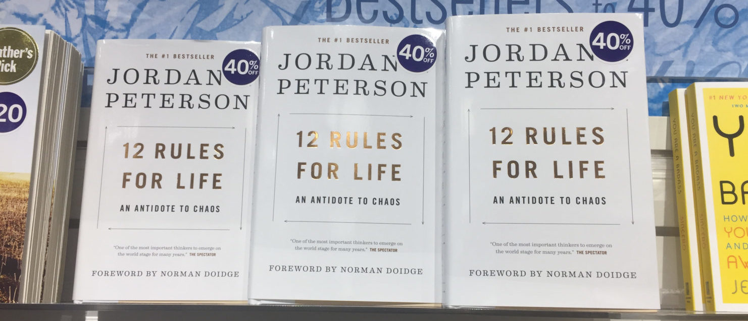 London Ontario Canada, August 10 2018: editorial photo of the bestseller 12 rules for life by Jordan Peterson. This book is being displayed as a bestseller in a bookstore. Shutterstock/Kaleb Kroetsch