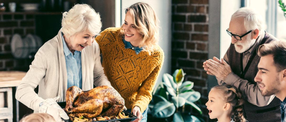 Grandma serving turkey (LightField Studios/Shutterstock)