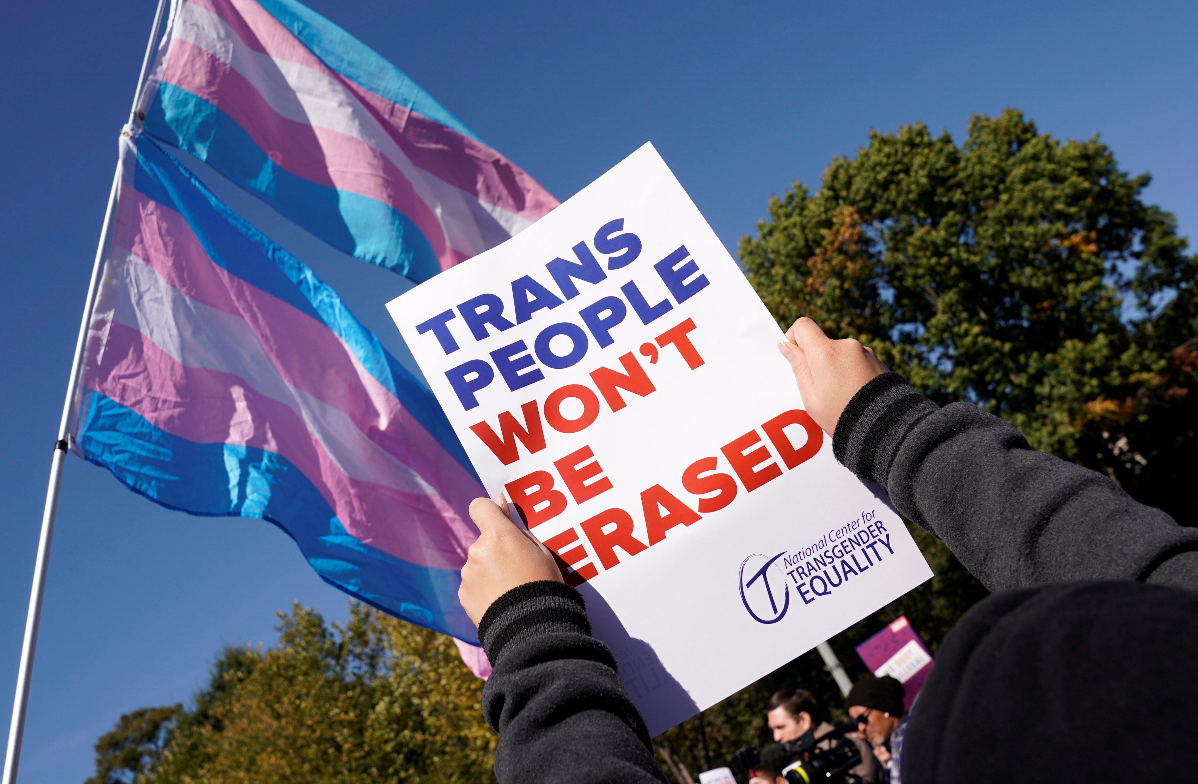 Transgender rights activists protest the government's alleged attempt to strip transgender people of official recognition at the White House in Washington, U.S., October 22, 2018. REUTERS/Kevin Lamarque