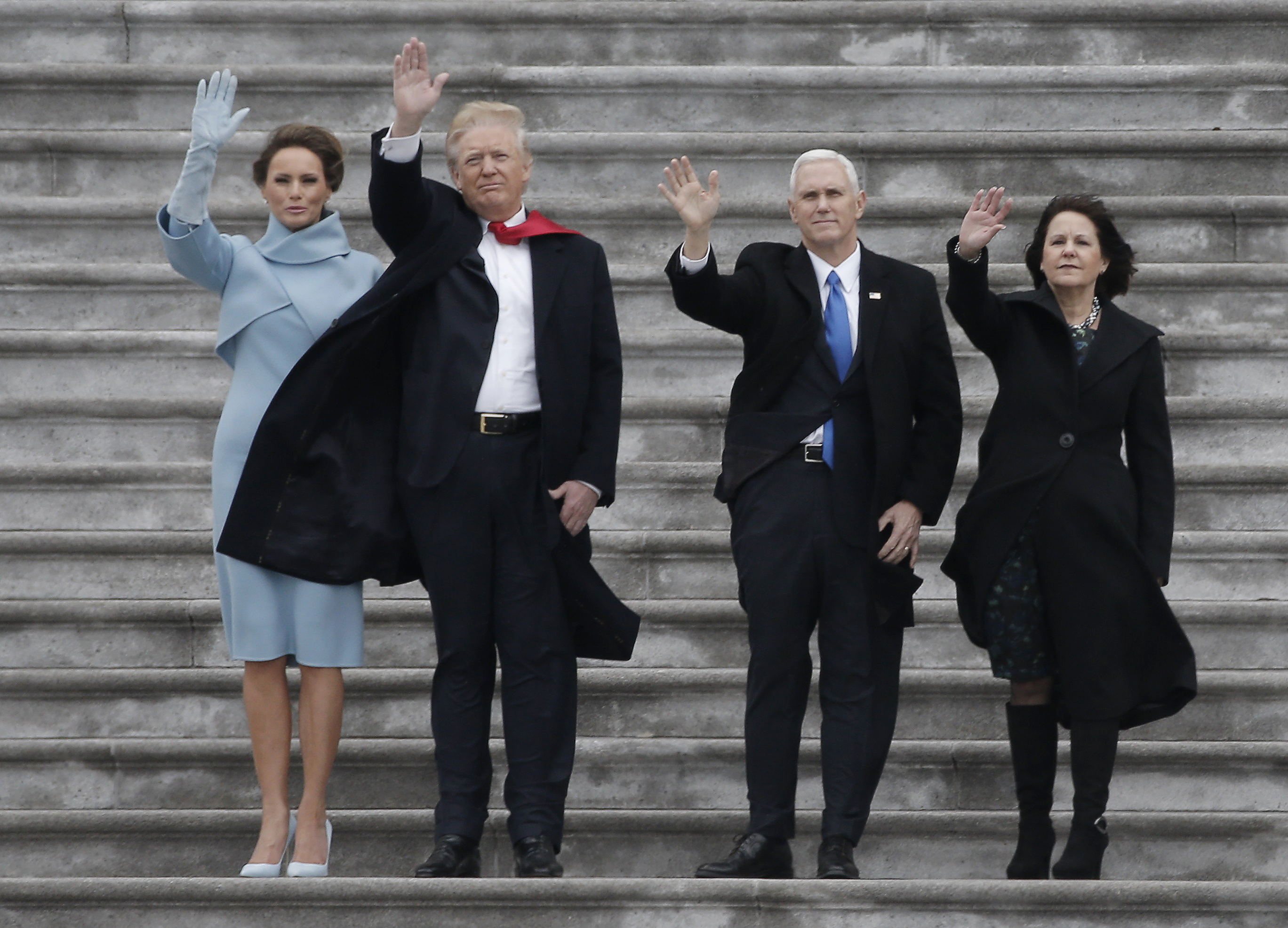 President Donald Trump, Melania Trump (L), Vice President Mike Pence and Karen Pence (R) wave as the Executive One helicopter departs carrying outgoing President Barack Obama and outgoing First Lady Michelle Obama following Trump's swearing ceremony in Washington, U.S., January 20, 2017. REUTERS/Mike Segar