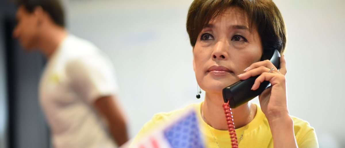 Republican candidate for US Congress Young Kim makes campaign calls to voters at her campaign office in Yorba Linda, California, October 6, 2018. - Kim, who immigrated to the US from her birth country of South Korea in 1975, would be the first Korean-American woman elected to the US House of Representatives if she defeats her Democratic opponent Gil Cisneros in the Midterm elections race for the open seat in California's 39th Congressional District which includes parts of Los Angeles, Orange, and San Bernardino counties (ROBYN BECK/AFP/Getty Images)