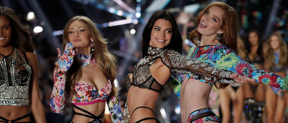 f8eceed05eb12 Model Kendall Jenner presents a creation with other models during the 2018 Victoria's  Secret Fashion Show