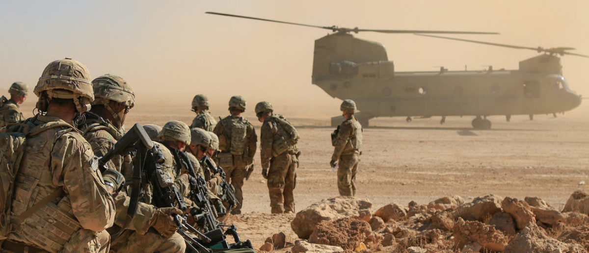 U.S. Soldiers assigned to Bandit Troop, 1st Squadron, 3rd Cavalry Regiment and deployed in support of Combined Joint Task Force – Operation Inherent Resolve await aerial extraction via CH-47 Chinook during an aerial response force live-fire training exercise in Iraq, Oct. 31, 2018. A number of training initiatives, collectively known as the Iraqi Air Enterprise, is underway across the Iraqi Air Force, Army Aviation, and Air Defense Commands. Continued growth towards Iraqi Security Forces (ISF) self-sufficiency will permit the Coalition to adjust the role and number of Coalition forces in Iraq in response to changing support requirements of the ISF. (U.S. Army National Guard photo by 1st Lt. Leland White)