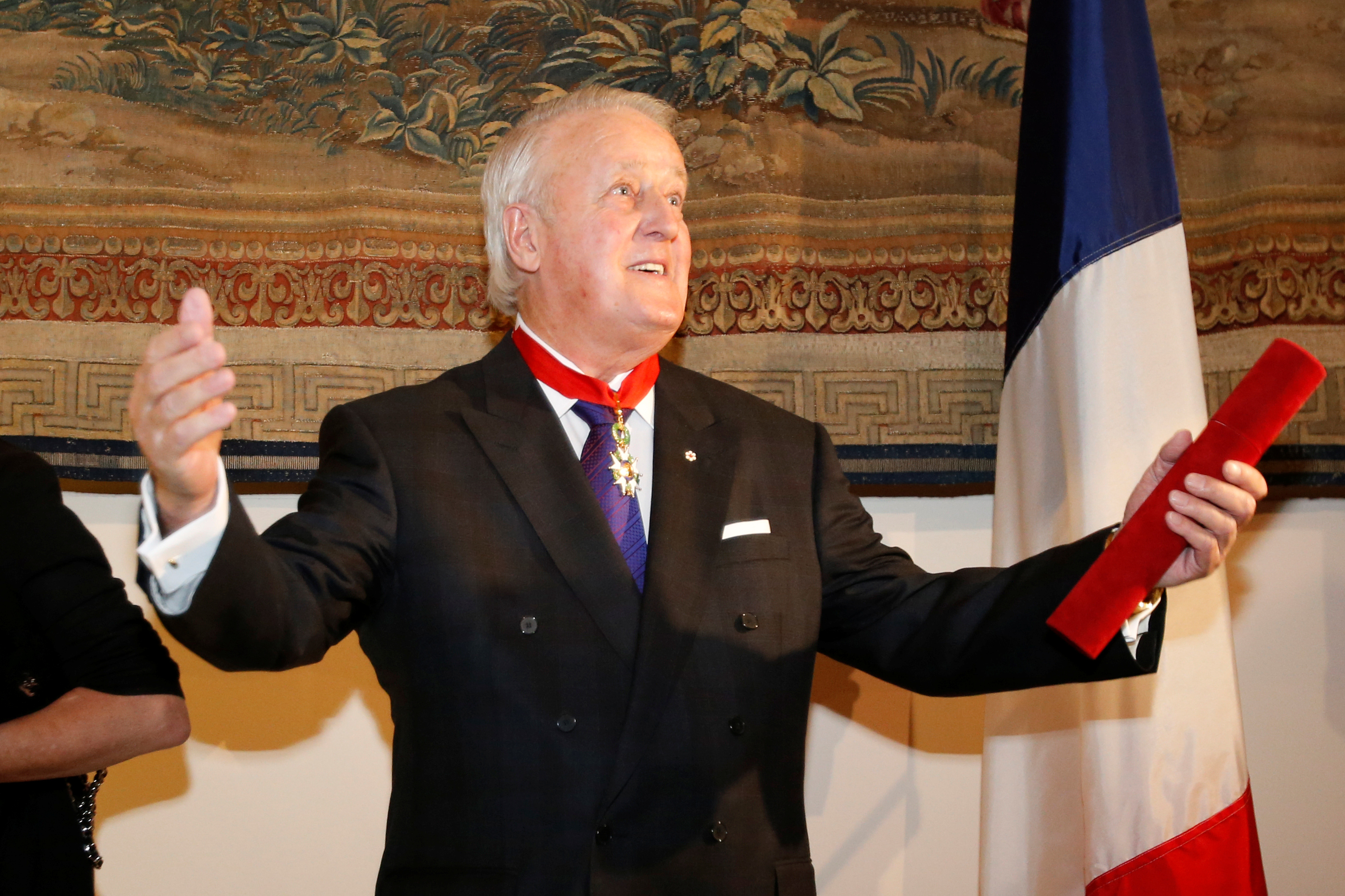 Former Canadian Prime Minister Brian Mulroney gestures after receiving the rank of Commander in the French Legion of Honour during a ceremony at the French embassy in Ottawa, Ontario, Canada, December 6, 2016. REUTERS/Chris Wattie - RC165409AEF0