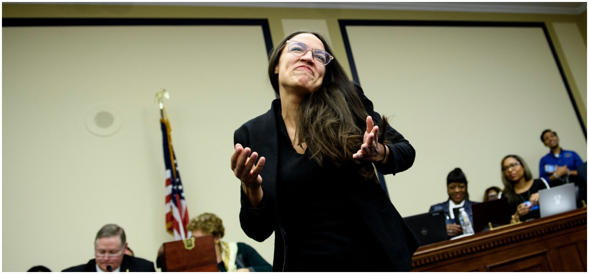 US Representative-elect Alexandria Ocasio-Cortez (D-NY) reacts after drawing a lottery number for her new office on Capitol Hill November 30, 2018 in Washington, DC. (Photo by Brendan Smialowski / AFP) (Photo credit should read BRENDAN