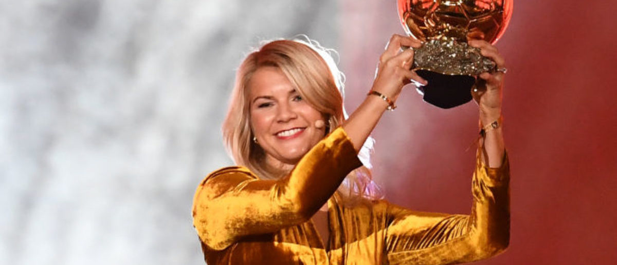 Olympique Lyonnais' Norwegian forward Ada Hegerberg brandishes her trophy after receiving the 2018 FIFA Women's Ballon d'Or award for best player of the year during the 2018 FIFA Ballon d'Or award ceremony at the Grand Palais in Paris on December 3, 2018. - The winner of the 2018 Ballon d'Or will be revealed at a glittering ceremony in Paris on December 3 evening, with Croatia's Luka Modric and a host of French World Cup winners all hoping to finally end the 10-year duopoly of Cristiano Ronaldo and Lionel Messi. (Photo by FRANCK FIFE / AFP) (Photo credit should read FRANCK FIFE/AFP/Getty Images)