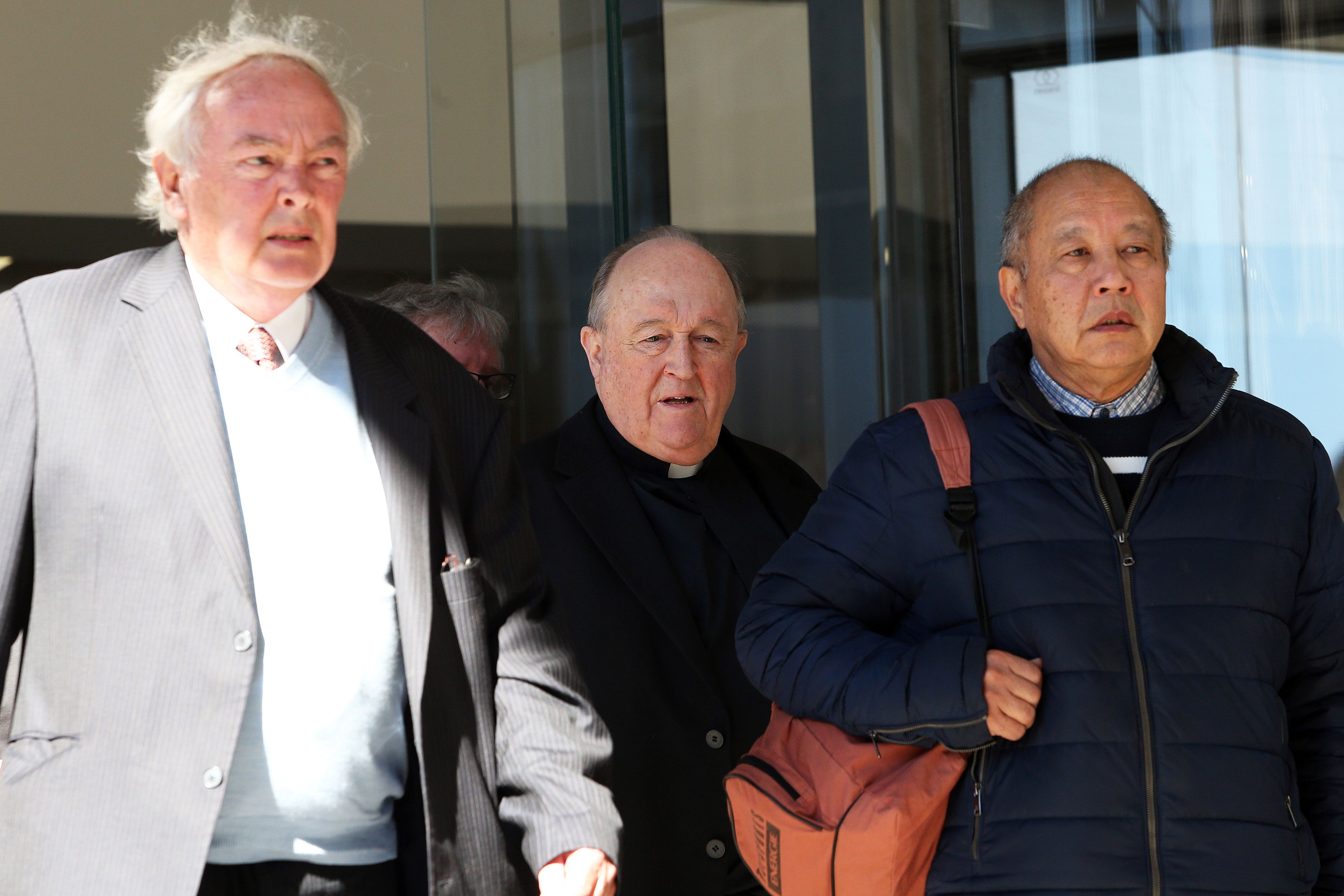 Former Australian archbishop Philip Wilson (C) leaves a court in Newcastle on August 14, 2018. - Wilson, a former Australian archbishop convicted of concealing abuse by a notorious paedophile priest in the 1970s, was spared jail on August 14, with a court ruling he can serve his sentence in home detention. (PETER LORIMER/AFP/Getty Images)