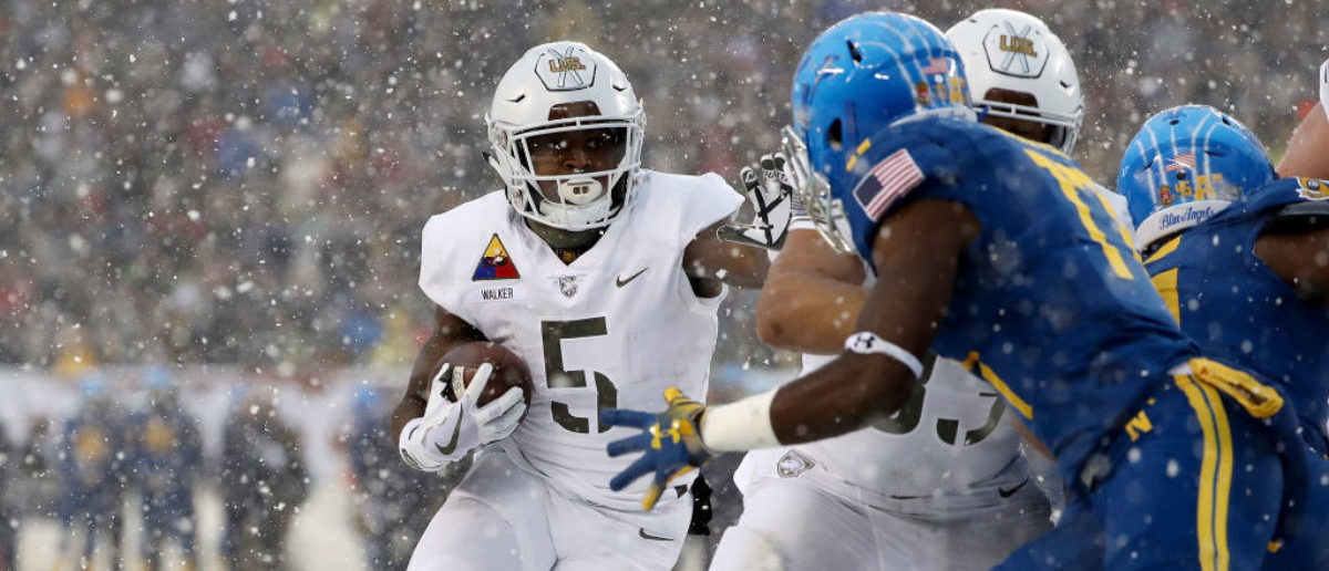 PHILADELPHIA, PA - DECEMBER 09: Kell Walker #5 of the Army Black Knights carries the ball in the first quarter against the Navy Midshipmen on December 9, 2017 at Lincoln Financial Field in Philadelphia, Pennsylvania. (Photo by Elsa/Getty Images)