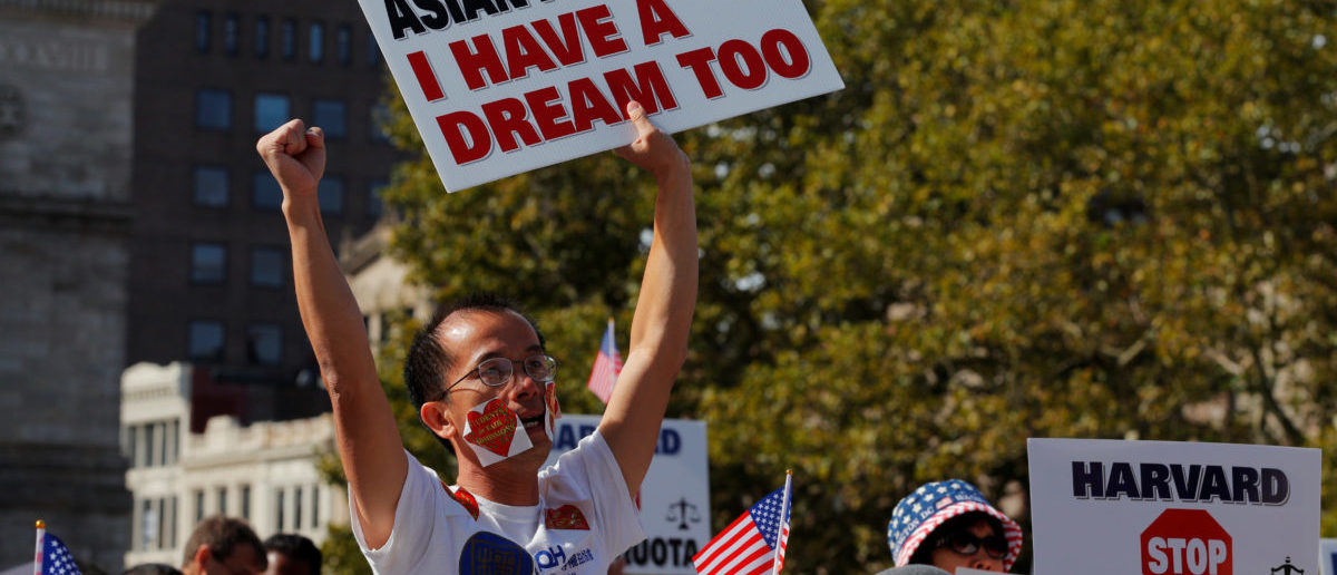 """Supporters attend the """"Rally for the American Dream - Equal Education Rights for All,"""" ahead of the start of the trial in a lawsuit accusing Harvard University of discriminating against Asian-American applicants, in Boston, Massachusetts, U.S., October 14, 2018. REUTERS/Brian Snyder"""