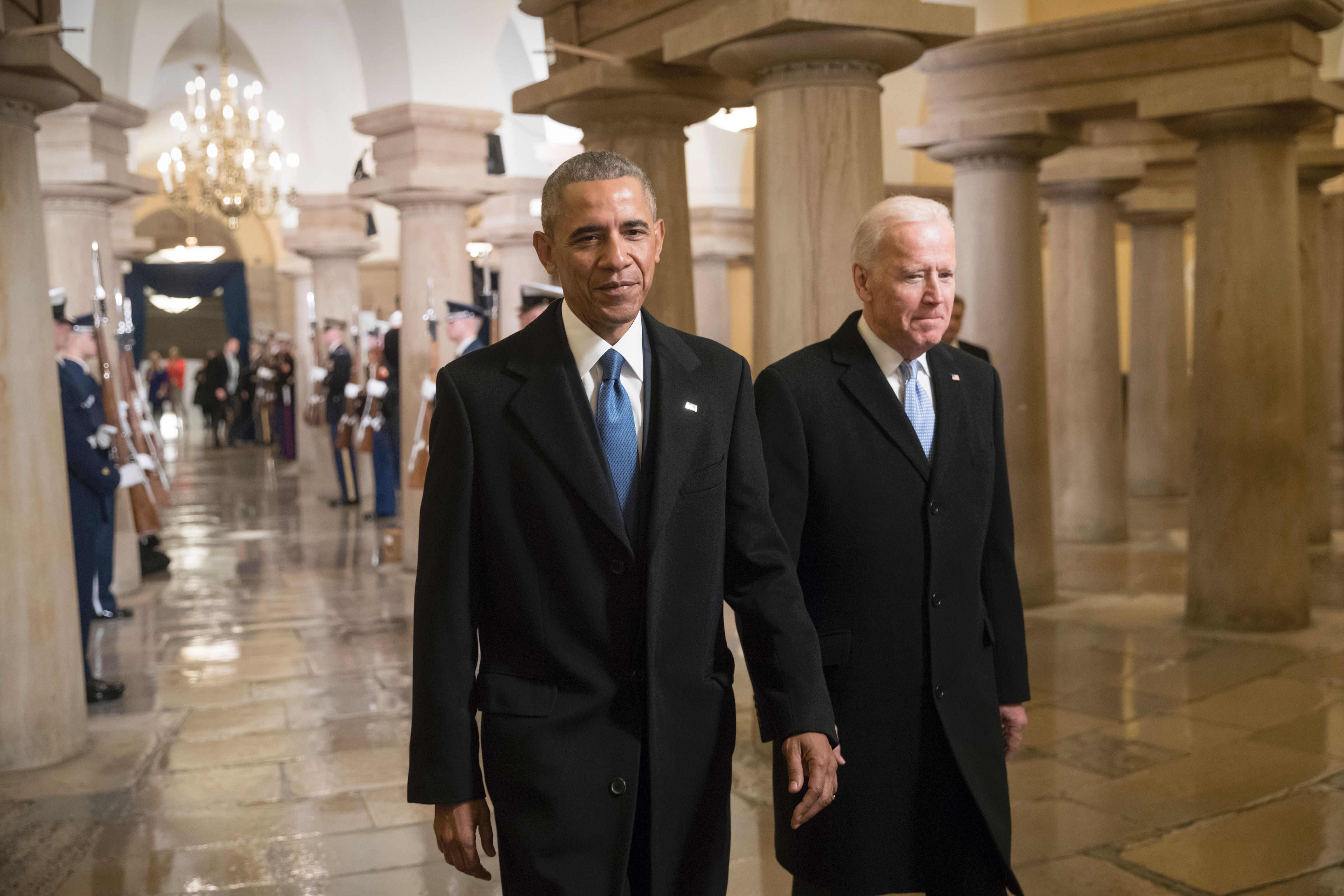 Barack Obama and Joe Biden walk through the Crypt of the Capitol for Donald Trump's inauguration ceremony (J. Scott Applewhite/AFP/Getty Images)