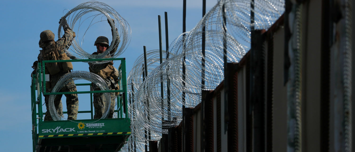 Marines deploy concertina wire at the U.S. Mexico border in preparation for the arrival of a caravan of migrants at the San Ysidro border crossing in San Diego. REUTERS/Mike Blake