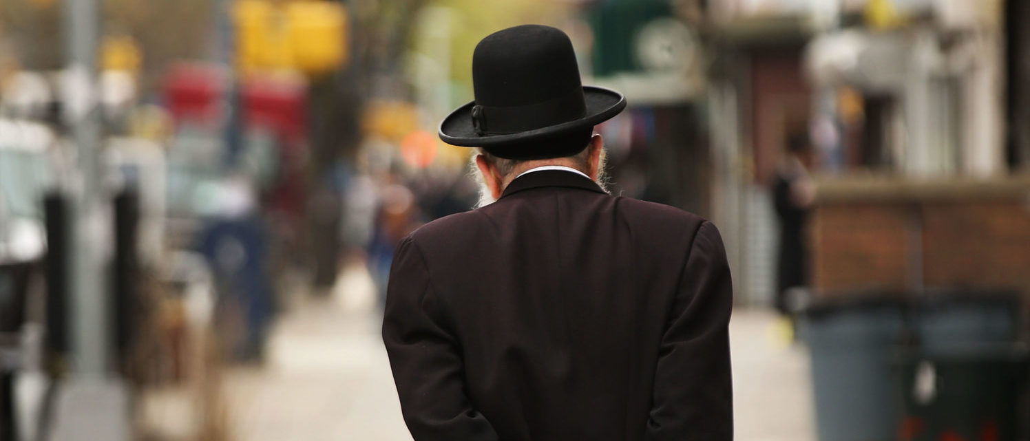 NEW YORK, NY - APRIL 24: A Hasidic man walks through a Jewish Orthodox neighborhood in Brooklyn on April 24, 2017 in New York City. According to a new report released by the Anti-Defamation League (ADL), anti-Semitic incidents in the U.S. rose by 86 percent in the first three months of the year. The group's audit of anti-Semitic events counted 541 anti-Semitic attacks and threats in the first quarter of the year, a significant increase over the same period last year. (Photo by Spencer Platt/Getty Images)
