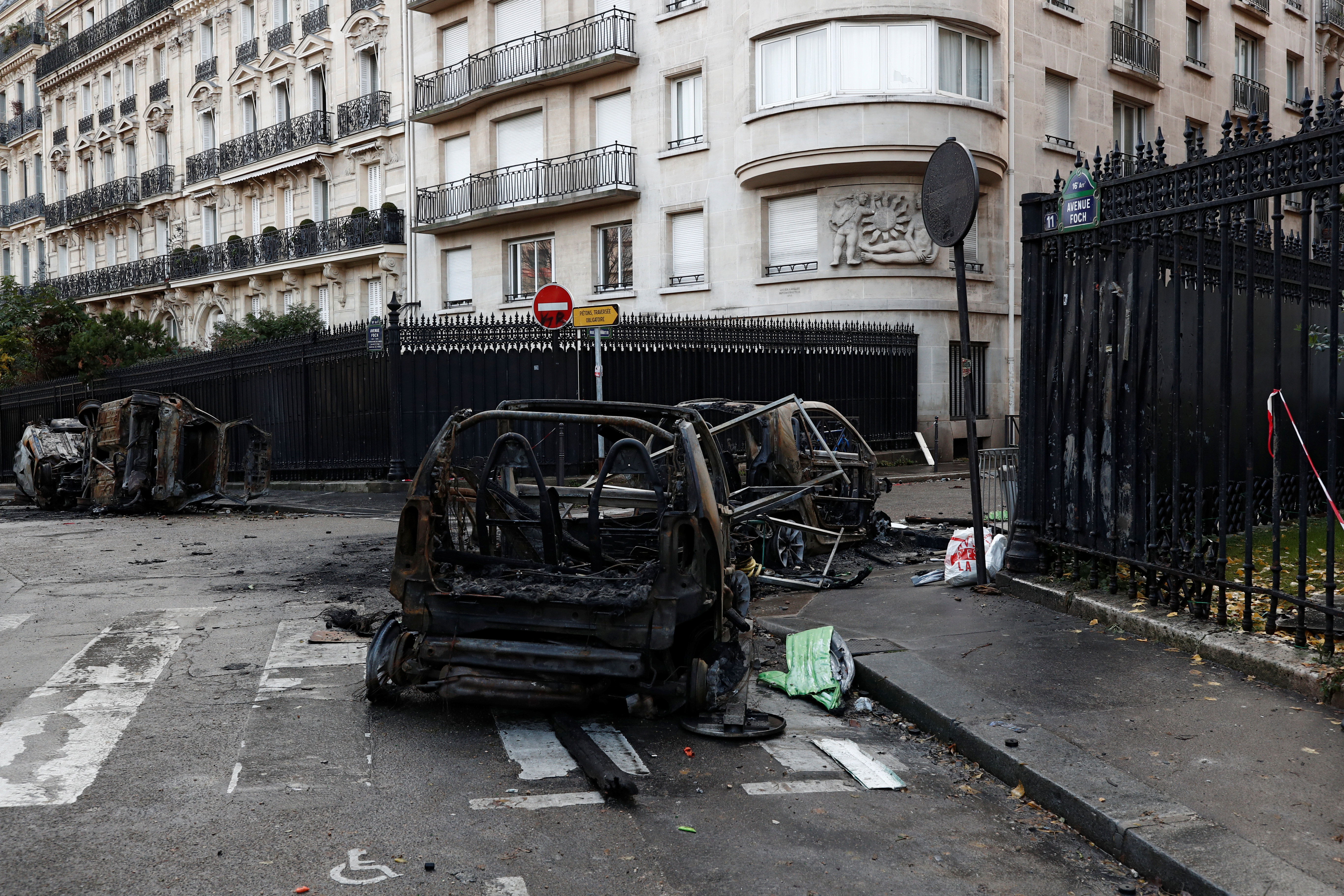 Vandalized cars are seen on a street the morning after clashes with protesters wearing yellow vests, a symbol of a French drivers' protest against higher diesel taxes, in Paris, France, December 2, 2018. REUTERS/Benoit Tessier