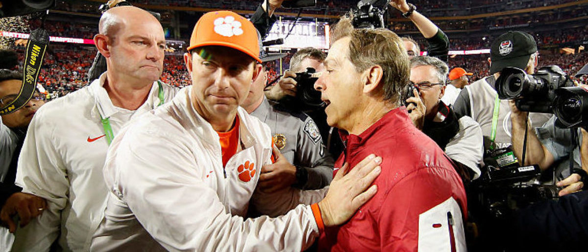GLENDALE, AZ - JANUARY 11: Head coach Nick Saban of the Alabama Crimson Tide shakes hands with head coach Dabo Swinney of the Clemson Tigers after the 2016 College Football Playoff National Championship Game at University of Phoenix Stadium on January 11, 2016 in Glendale, Arizona. The Crimson Tide defeated the Tigers with a score of 45 to 40. (Photo by Christian Petersen/Getty Images)