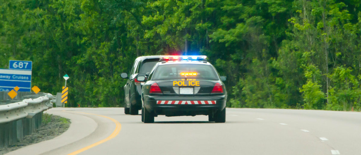 A man filmed a car driving recklessly in an effort to escape cops during a high-speed chase in Maine, until the car swerved uncontrollably off the road, hitting the videographer and his passengers. (Shutterstock/Adwo)