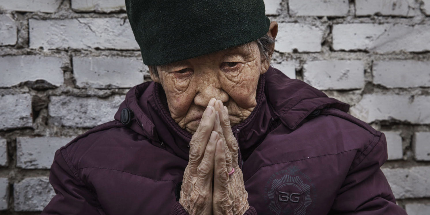 """Chinese Christians Mark Holy Week At Underground Church. A Chinese Catholic worshipper prays at a Palm Sunday Mass during the Easter Holy Week at an """"underground"""" or """"unofficial"""" church on April 9, 2017 near Shijiazhuang, Hebei Province, China. China, an officially atheist country, places a number of restrictions on Christians, allowing legal practice of the faith only at state-approved churches. The policy has driven an increasing number of Christians and Christian converts 'underground' to secret congregations in private homes and other venues. (Photo by Kevin Frayer/Getty Images)"""