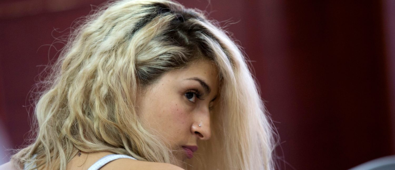Colombian Yulieth Lozano, alleged member of a prostitution network, is pictured before a hearing at a court in Medellin, Colombia, on Dec. 10, 2018. (JOAQUIN SARMIENTO/AFP/Getty Images)