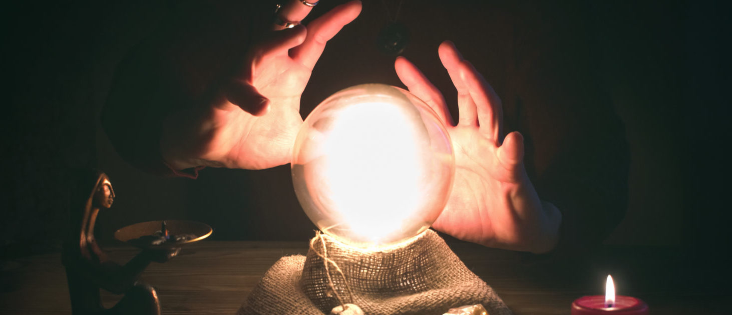 Psychic with a Crystal Ball (Shutterstock/n_defender)