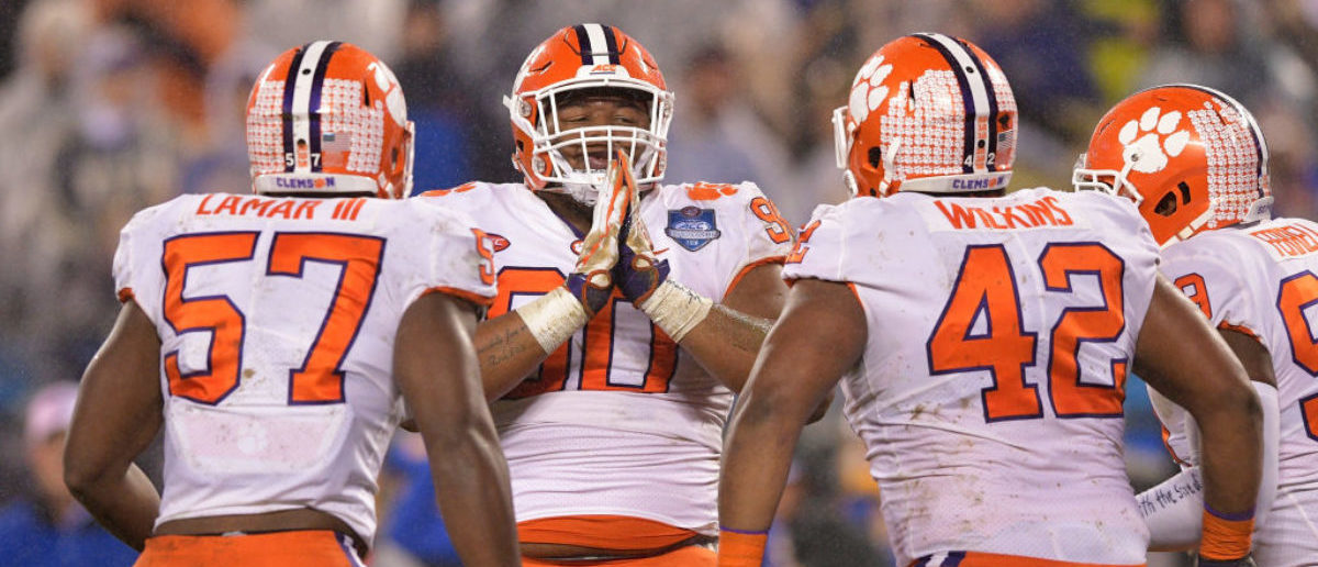 CHARLOTTE, NC - DECEMBER 01: Dexter Lawrence #90 and teammates Tre Lamar #57 and Christian Wilkins #42 of the Clemson Tigers react against the Pittsburgh Panthers in the first quarter during their game at Bank of America Stadium on December 1, 2018 in Charlotte, North Carolina. (Photo by Grant Halverson/Getty Images)
