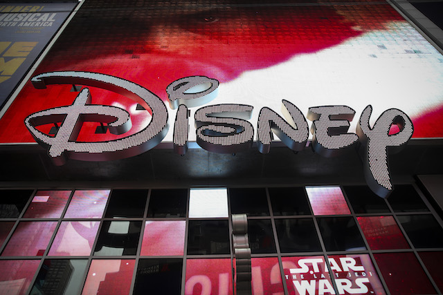 The Disney logo is displayed outside the Disney Store in Times Square, December 14, 2017 in New York City. The Walt Disney Company announced on Thursday morning that it had reached a deal to purchase most of the assets of 21st Century Fox. The deal has a total value of around $66 billion, with Disney assuming $13.7 billion of Fox's net debt. (Photo by Drew Angerer/Getty Images)