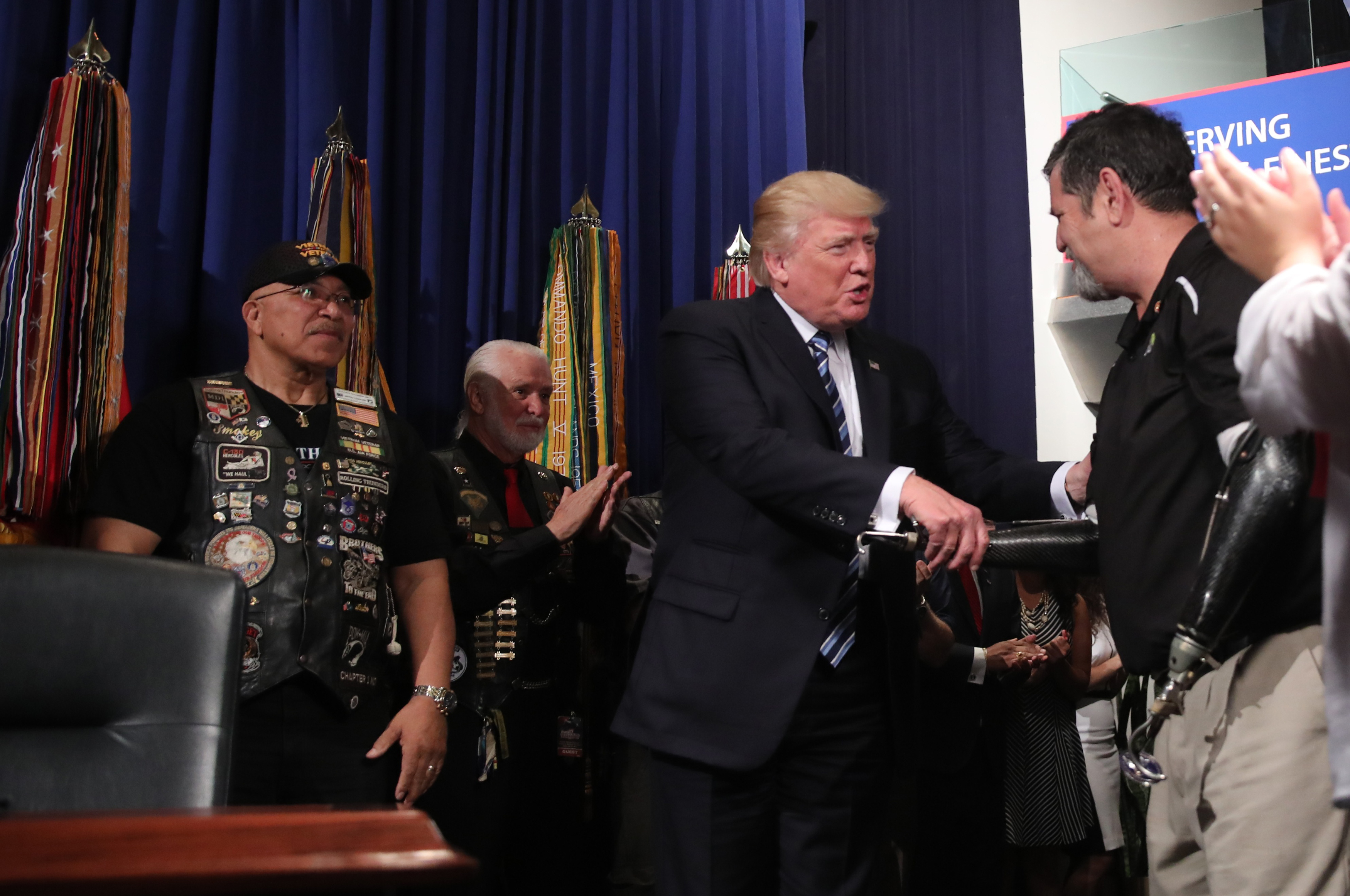 U.S. President Donald Trump greets veterans prior to signing an Executive Order on improving accountability and whistleblower protection, at the Veterans Affairs Department in Washington, April 27, 2017. REUTERS/Carlos Barria