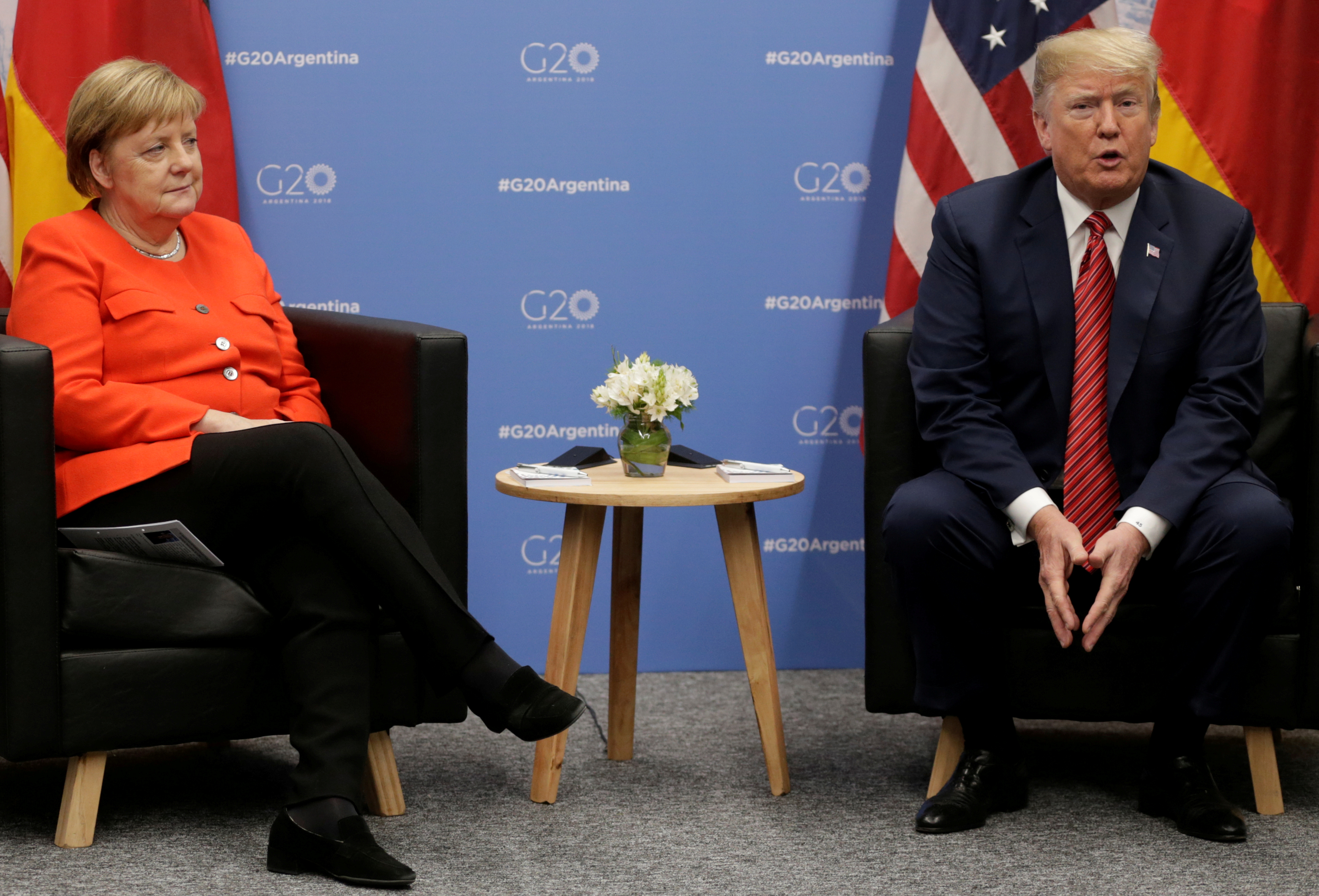 U.S. President Donald Trump and German Chancellor Angela Merkel attend a meeting during the G20 leaders summit in Buenos Aires, Argentina December 1, 2018. REUTERS/Luisa Gonzalez