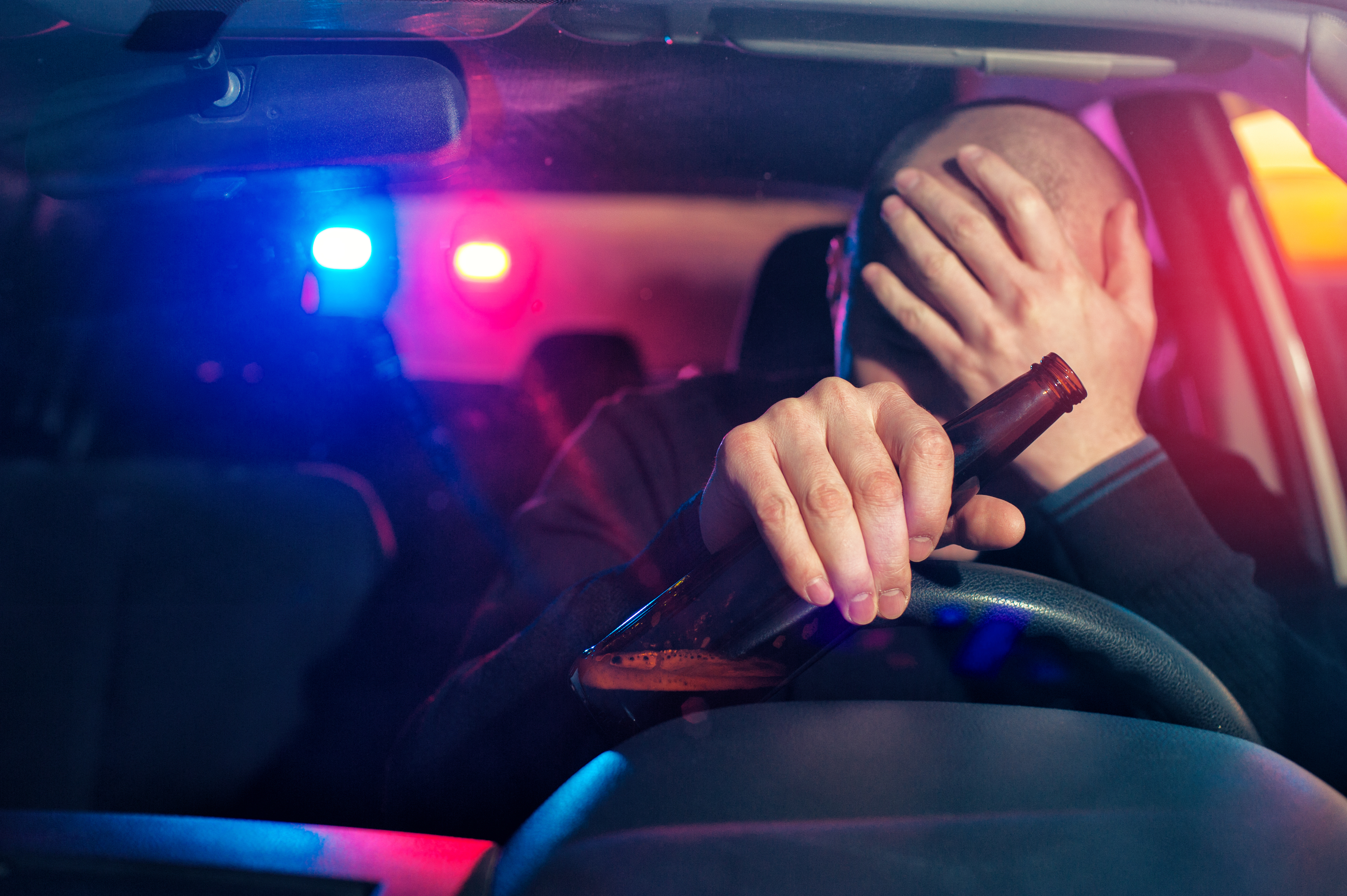 Police pull a man over for drunk driving (Shutterstock/Paul Biryukov)