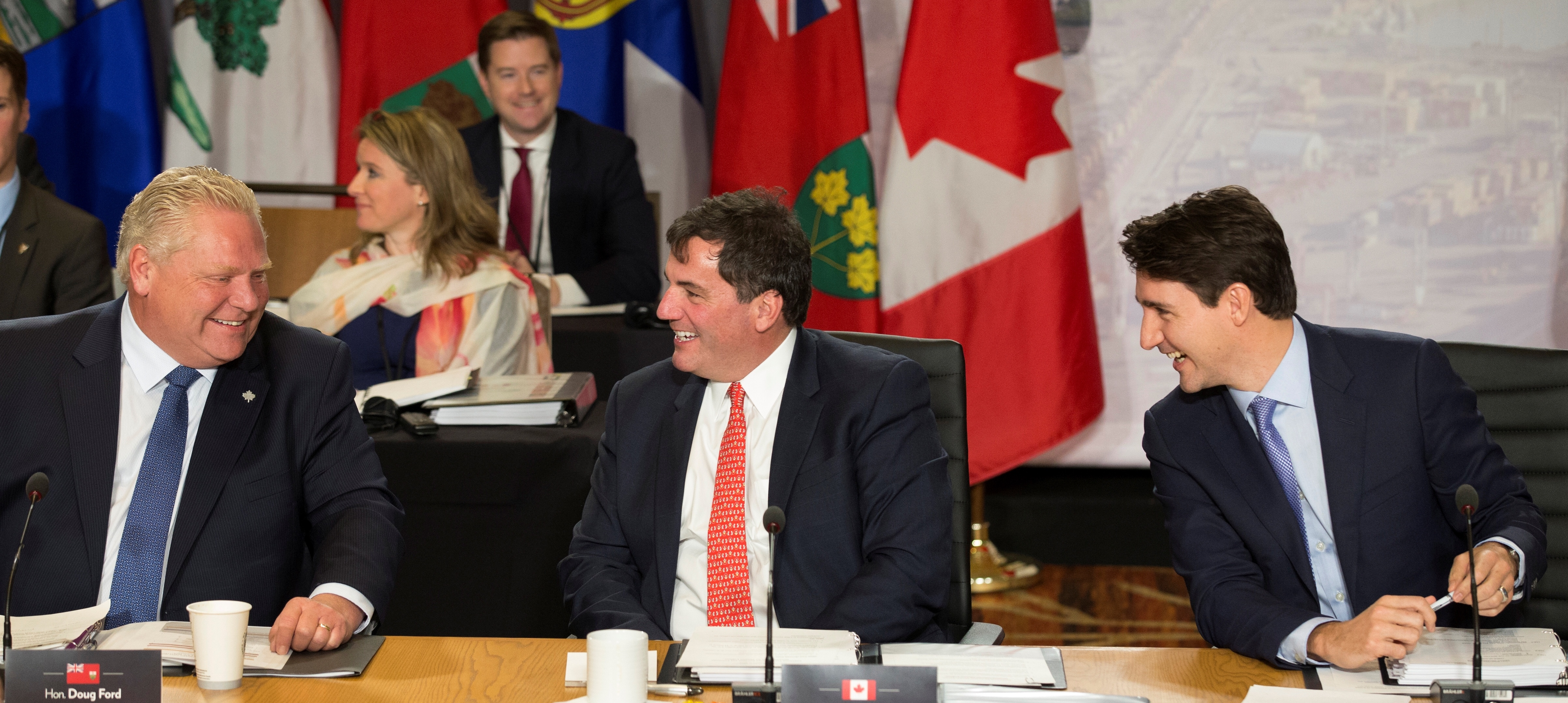 Canadian Prime Minister Justin Trudeau (R) laughs with Ontario Premier Doug Ford (L) and Minister of Intergovernmental Affairs Dominic LeBlanc as they wait to begin the First Ministers' Meeting in Montreal, Quebec, Canada, December 7, 2018.REUTERS/Christinne Muschi