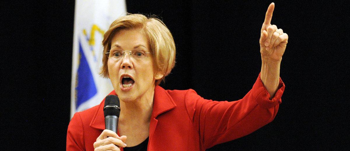 Senator Elizabeth Warren addresses a town hall meeting in Roxbury, Massachusetts (Joseph Prezioso/AFP/Getty Images)