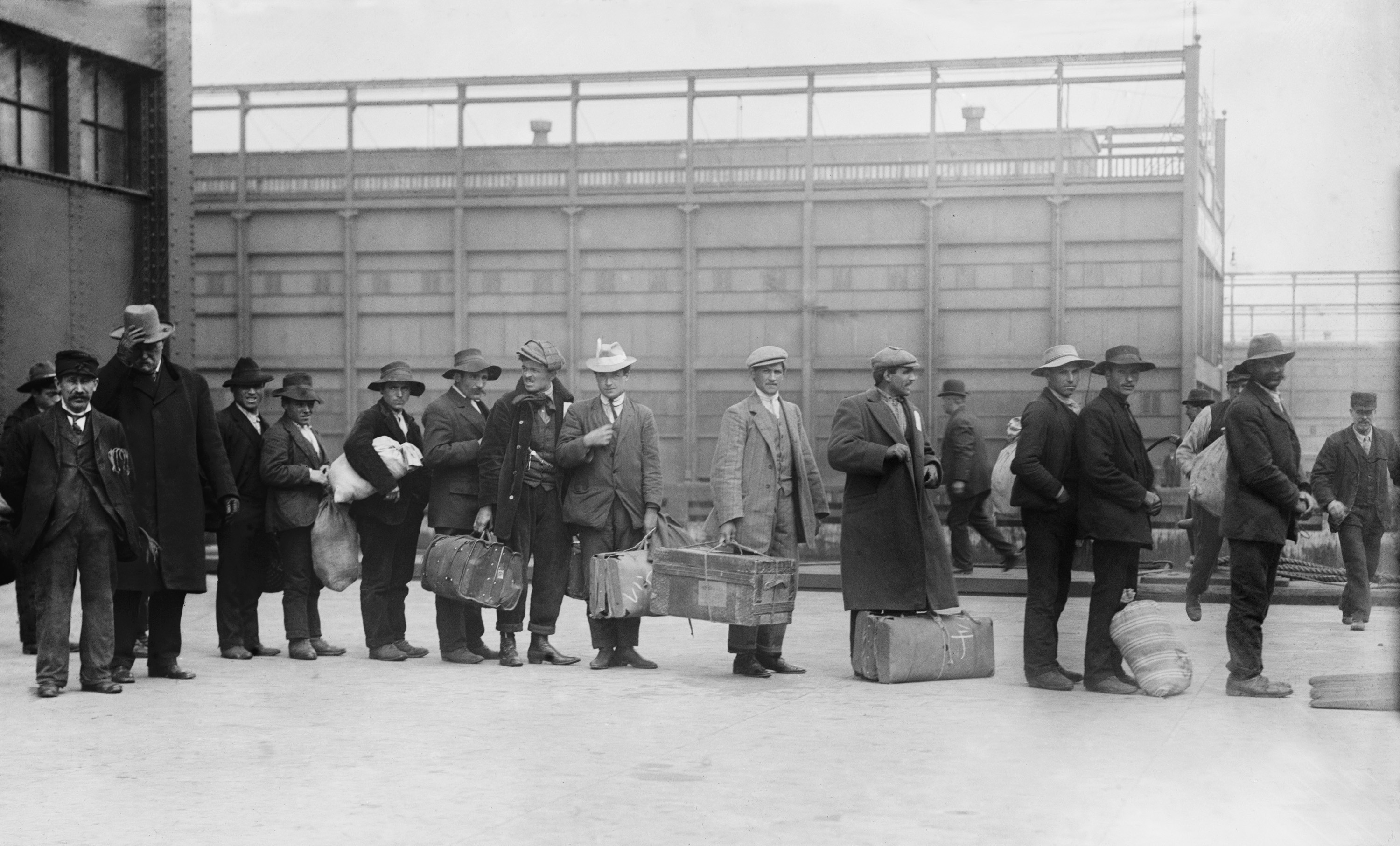 Pictured are immigrants on Ellis Island. SHUTTERSTOCK/ Everett Historical