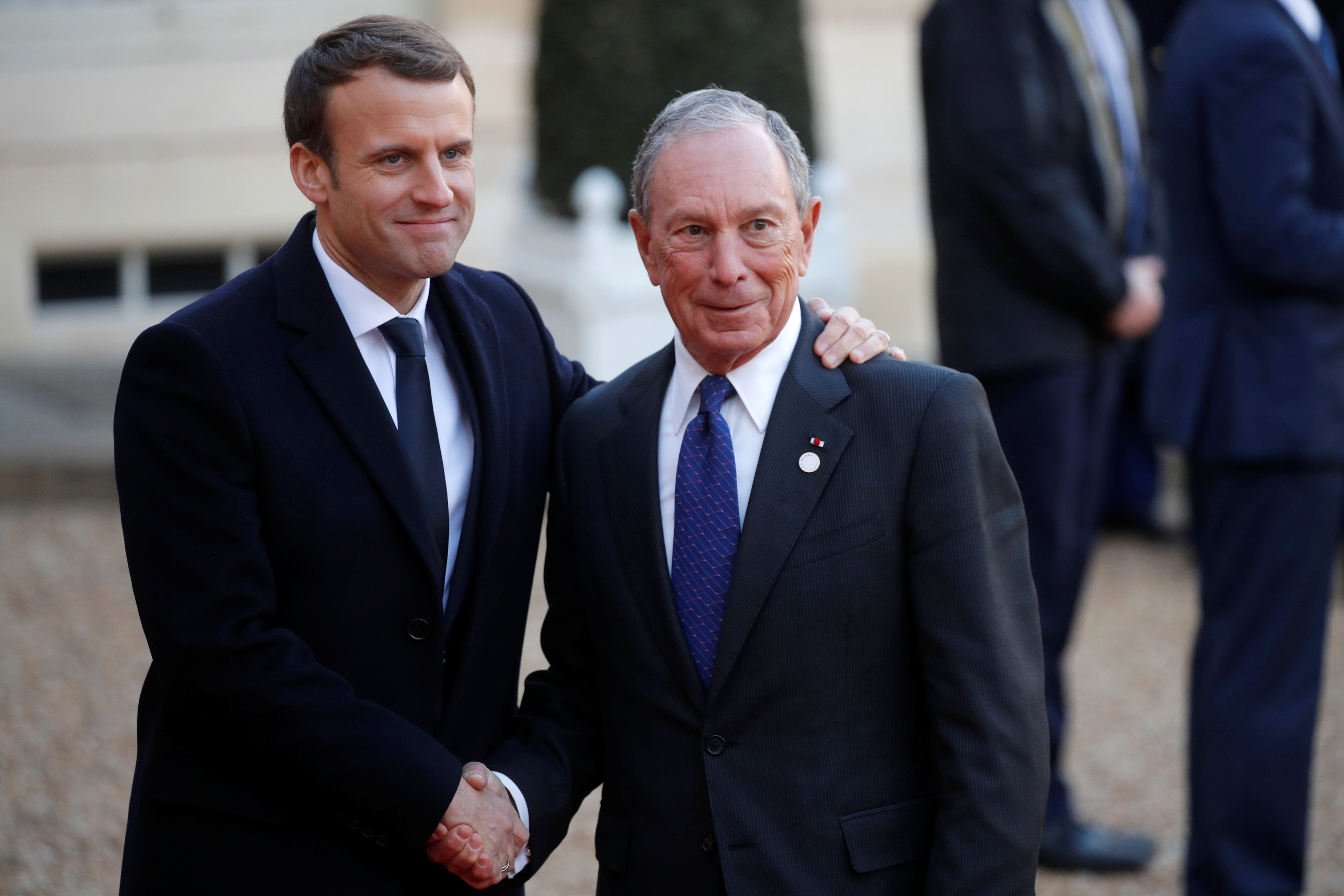 French President Emmanuel Macron welcomes Special envoy to the United Nations for climate change Michael Bloomberg as he arrives for a lunch at the Elysee Palace as part of the One Planet Summit in Paris, France, December 12, 2017. REUTERS/Philippe Wojazer