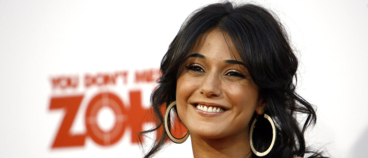 """Cast member Emmanuelle Chriqui smiles at the movie premiere of """"You Don't Mess with the Zohan"""" at the Grauman's Chinese theatre in Hollywood, California May 28, 2008. The movie opens in the U.S. on June 6. REUTERS/Mario Anzuoni"""