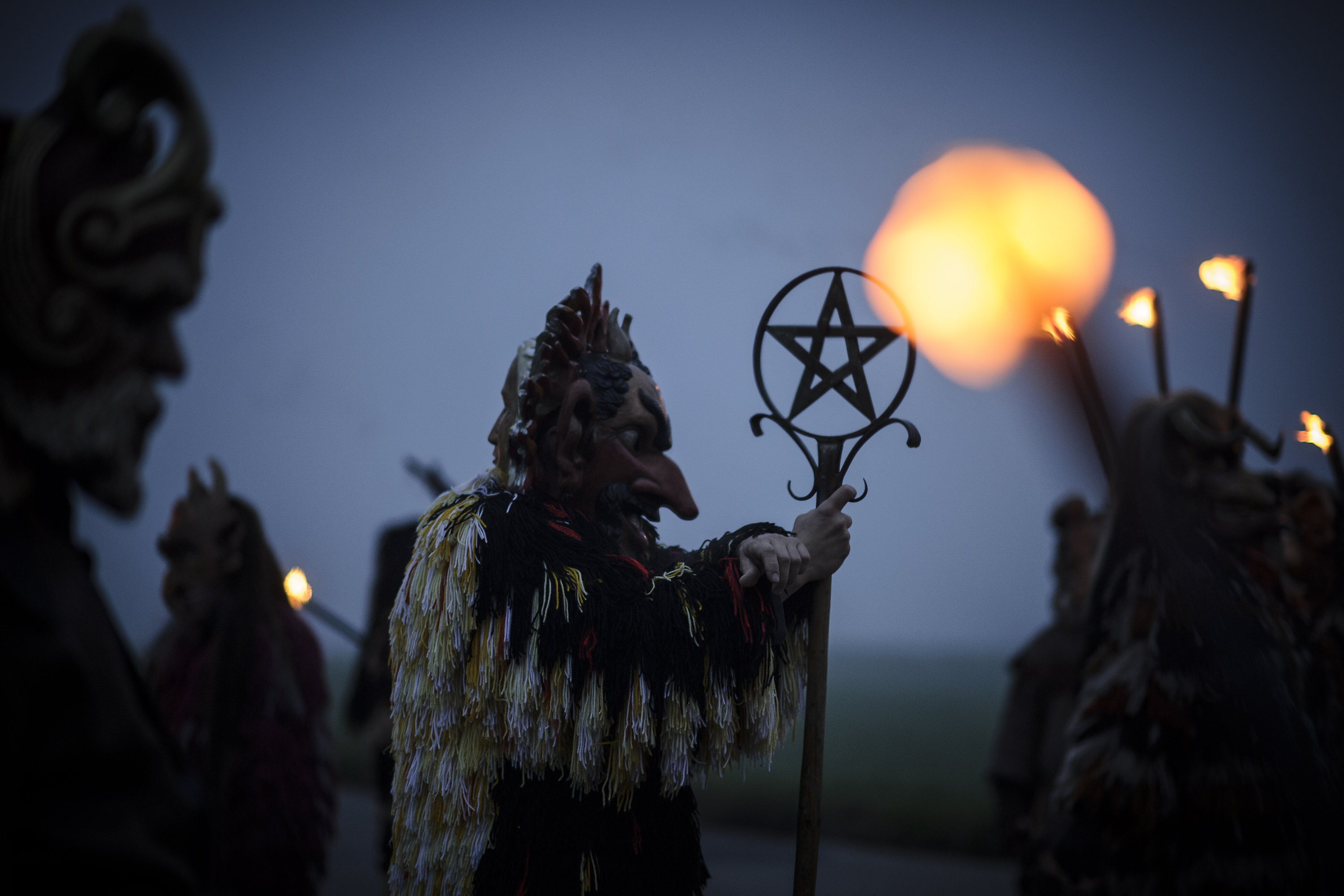 Participants dressed as Perchten roam village streets to chase away evil winter spirits in the annual Perchten gathering in Bavaria on November 29, 2014 near Kirchseeon, Germany. Perchten are the mythical entourage of Perchta, a goddess in ancient southern German alpine pagan tradition, and are usually fearsome creatures with tusks and horns and covered in hair. The tradition dates back at least to the 16th century and is also related to traditions of Krampus, Teifel, Klausen and La Befana, all animal-like creatures in the German, Austrian, Italian and Swiss alpine regions whose duties include instilling fear into naughty children. (Photo by Philipp Guelland/Getty Images)