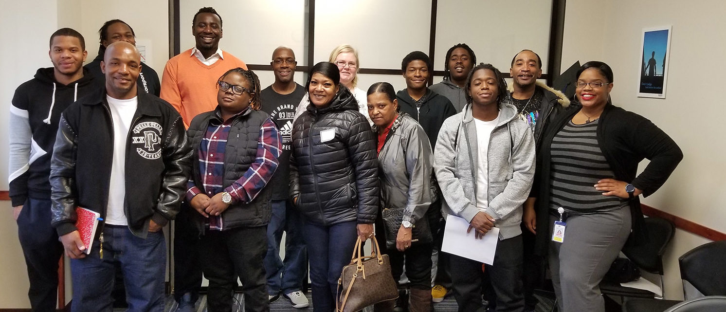 Kayla Woodland (far right), the employment coordinator at the GEO re-entry center in Chicago's Chatham neighborhood, leads a job session on Nov. 2, 2018. (Photo courtesy of GEO Care)
