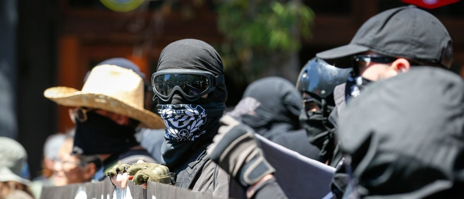 Antifa militants march with counter protesters, as they protest an alt-right rally on August 5, 2018 in downtown Berkeley, California. (Photo by AMY OSBORNE/AFP/Getty Images)