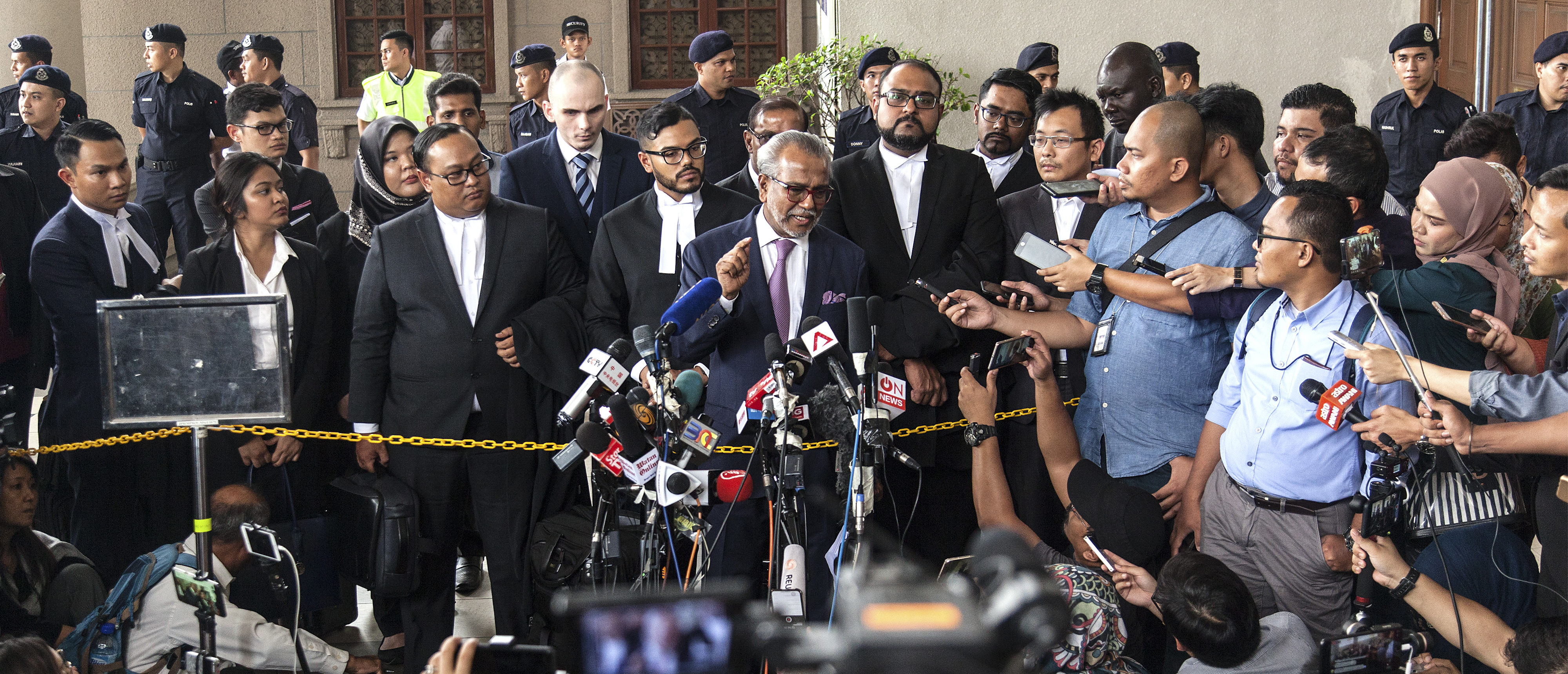 KUALA LUMPUR, MALAYSIA - AUGUST 08: Najib Razak's lawyer Muhammad Shafee Abdullah addresses the media outside the Kuala Lumpur High Court on August 8, 2018 in Kuala Lumpur, Malaysia. Malaysia's former Prime Minister Najib Razak was charged with three counts of money laundering on Wednesday after being hit with new charges in connection with a multi-billion-dollar scandal at state fund 1Malaysia Development Berhad (1MDB) that contributed to his shock election defeat by 93-year-old veteran politician Mahathir Mohamad in May. Najib faces up to 15 years in jail for each charge as he pleaded not guilty to the charges and was released on bail.(Photo by Ore Huiying/Getty Images)