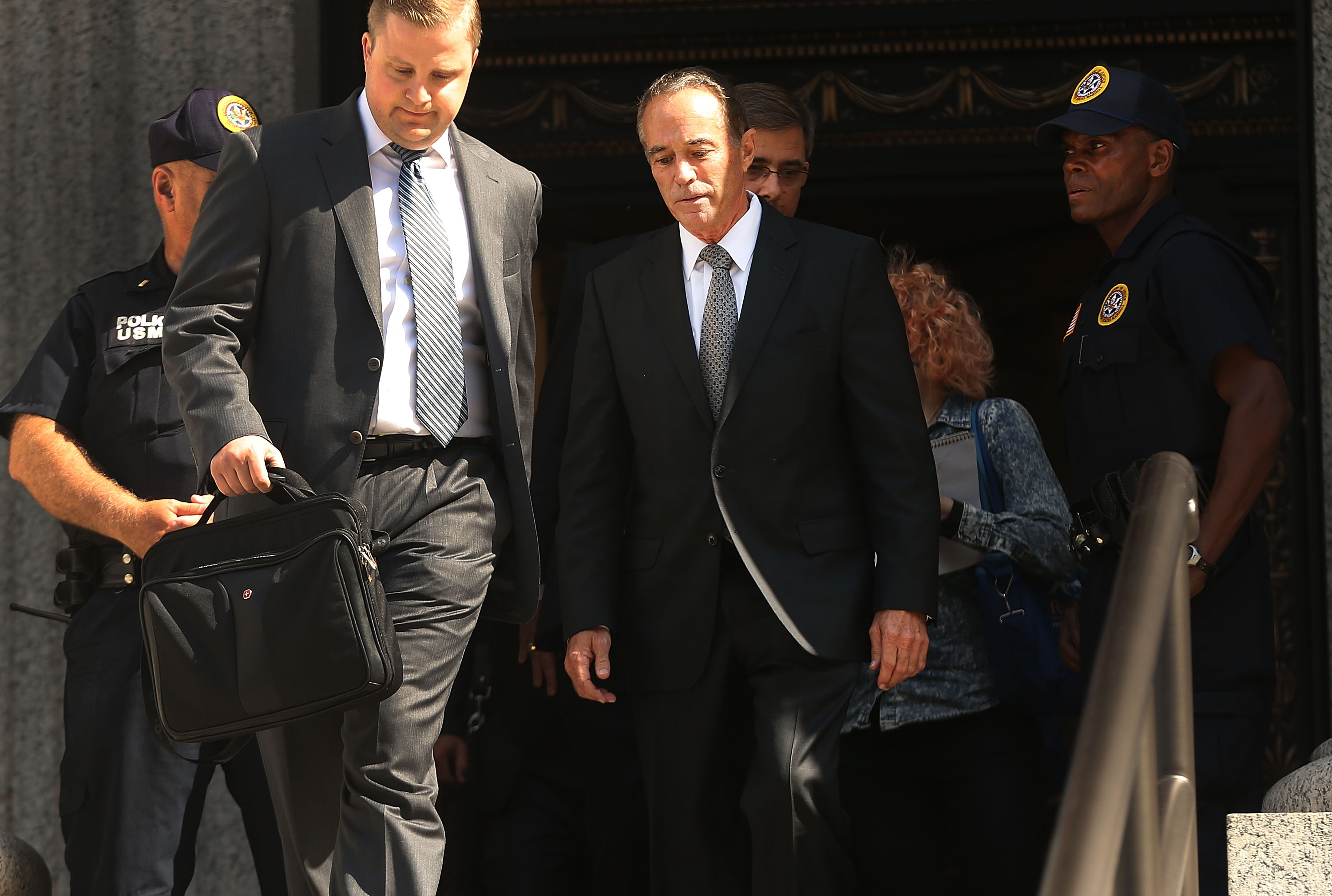 Rep. Chris Collins walks out of a New York court house after being charged with insider trading on August 8, 2018 in New York City. (Photo by Spencer Platt/Getty Images)