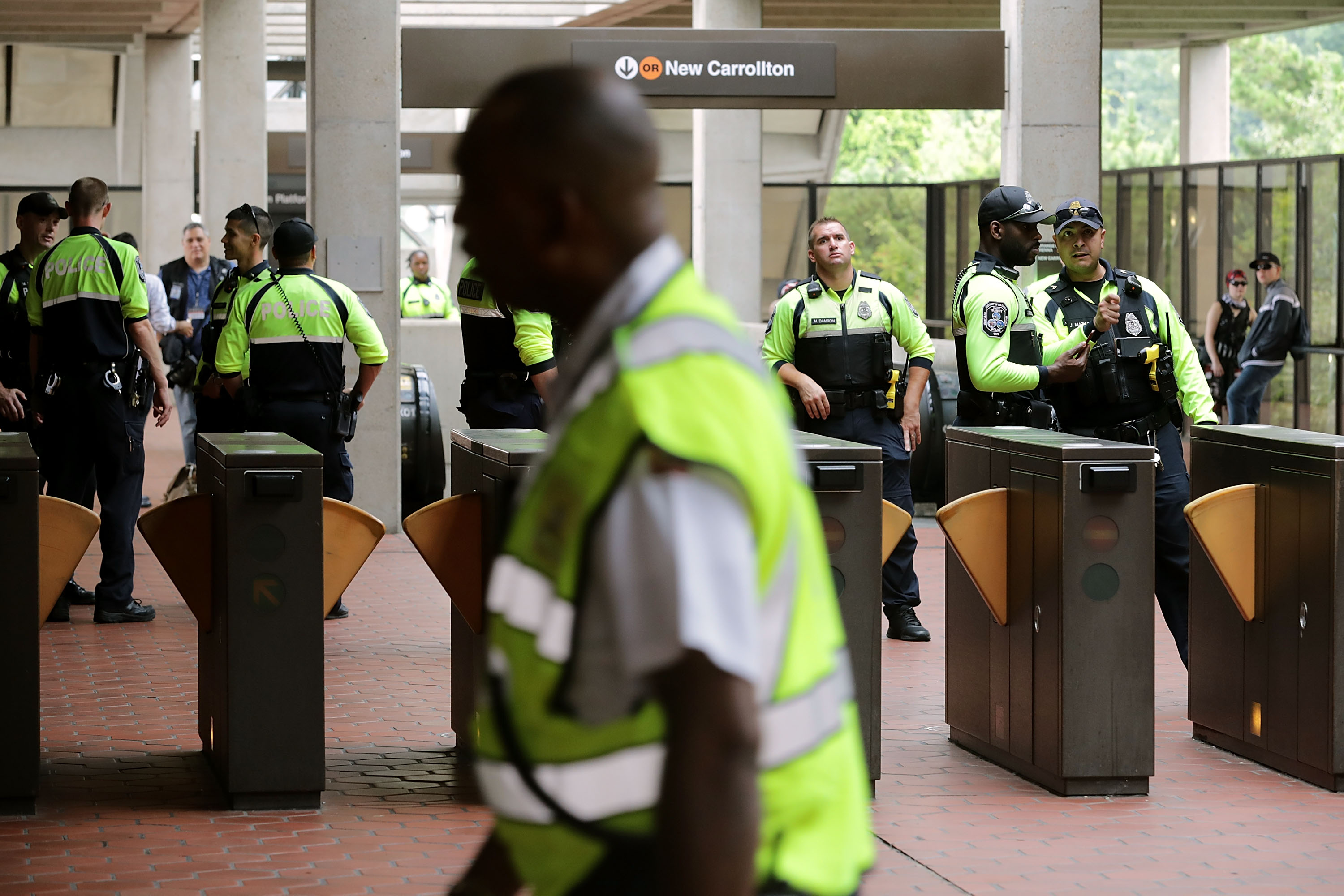 VIENNA, VA - AUGUST 12: Police stand watch at the Vienna/Fairfax GMU Metro Station in anticipation of the arrival of the white supremacist Unite the Right participants who plan to gather at the station before traveling to the White House August 12, 2018 in Vienna, Virginia. (Photo by Chip Somodevilla/Getty Images)