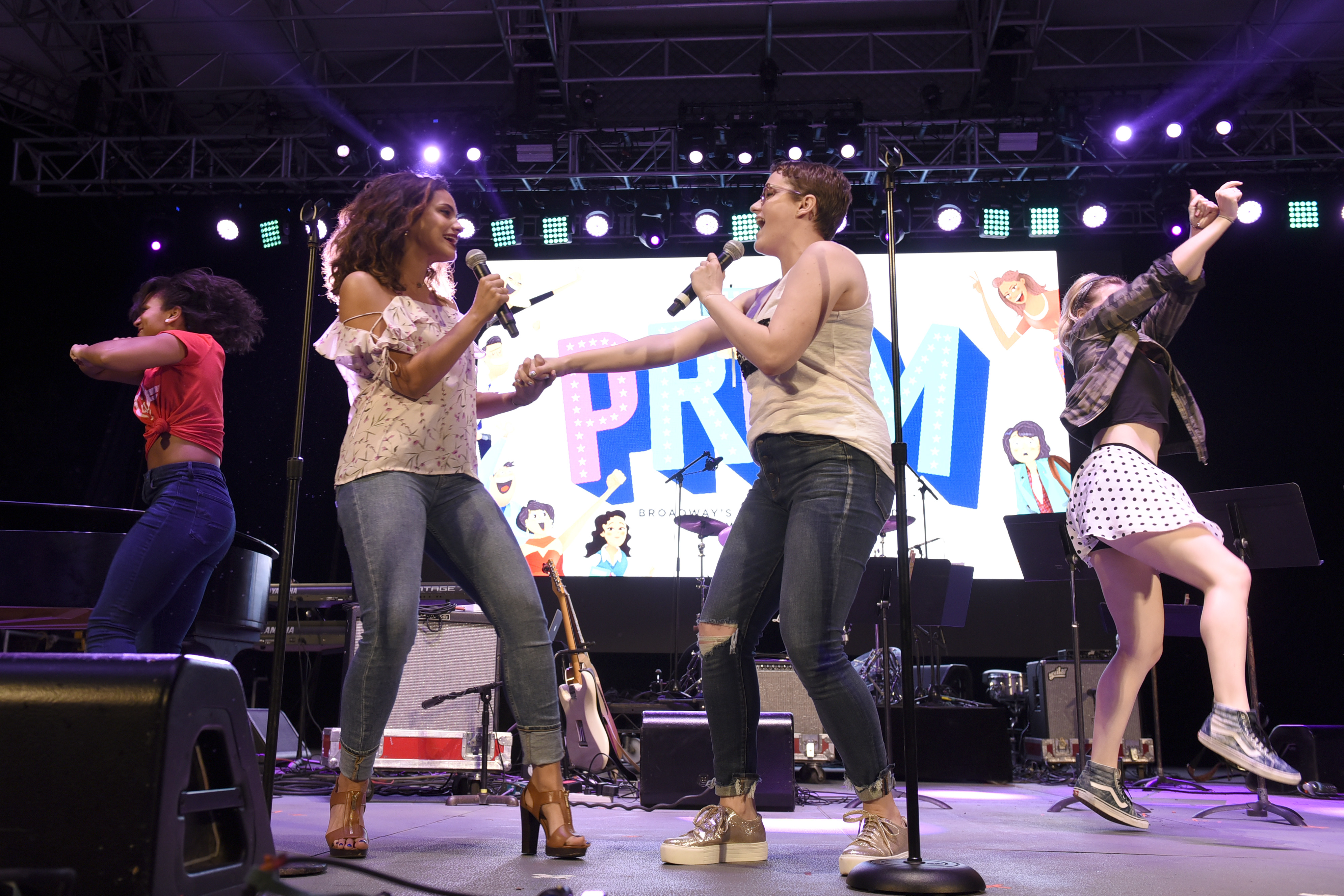 NEW YORK, NY - OCTOBER 07: Isabelle McCalla, Caitlin Kinnunen, and the cast of The Prom perform onstage during the 4th Annual Elsie Fest, Broadway's Outdoor Music Festival at Central Park SummerStage on October 7, 2018 in New York City. (Photo by Jenny Anderson/Getty Images for Elsie Fest)